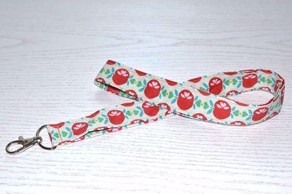 Bild von Schlüsselband Äpfelchen rot/beige